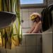 Photograph of a sham Mexican in the bathtub