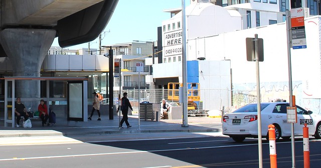 Bus stop underneath the skyrail at Carnegie