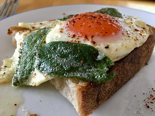 Eating a piece of toast with an egg and fried sage leaves on top. 🍳 | by adactio