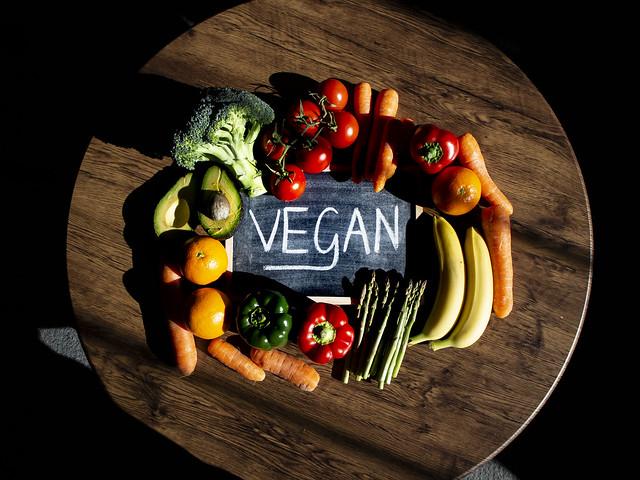 Vegan Written On Blackboard, surrounded by vegan friendly food