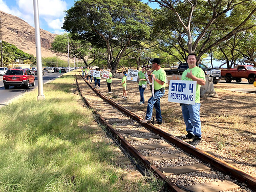 "Hawaiian Electric at the Valley of the Rainbows ""Drive with Aloha"" Sign Waving event — April 11, 2019: Remember to stop for pedestrians. And pedestrians, remember to look out for cars when crossing the street! 