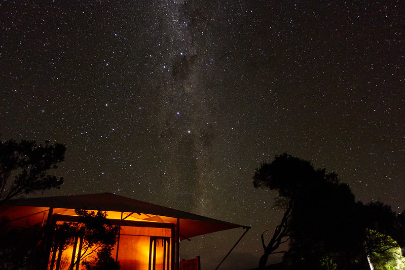 Image of glamping space located under clear night sky that is close to nature