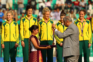 Members of the hockeyroos receive their gold medals from Commonwealth Secretary General Kamalesh Sharma at the 2010 Commonwealth Games | by Commonwealth Secretariat