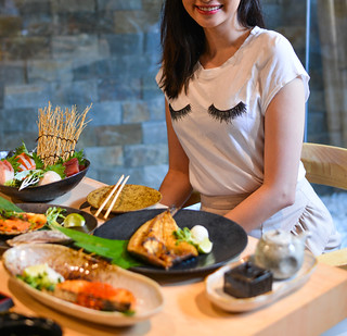 Woman eating and enjoying Japanese meal | by phuong.sg@gmail.com