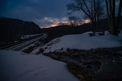 07t amtk99 amtrak amtrakpennsylvanian cassandraoverlook ns07t pennsylvanian snow sunset train winter creek dusk leaves naturalspring overlook railfan railfanoverlook railroad spring water