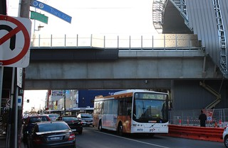 Bus underneath the skyrail at Carnegie | by Daniel Bowen