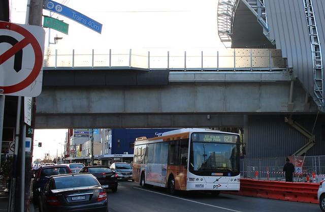 Bus underneath the skyrail at Carnegie