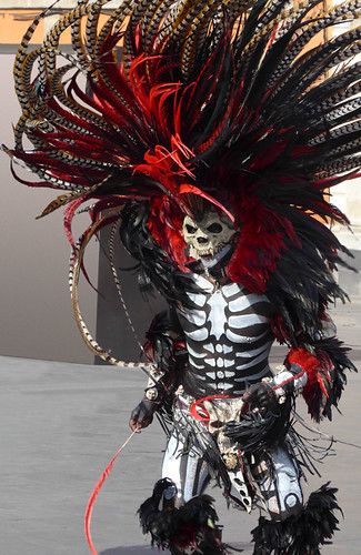 Aztec dancer dressed as a skeleton with an extraordinary feathered headdress