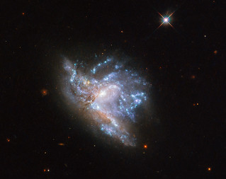 Hubble's Dazzling Display of Two Colliding Galaxies | by NASA Goddard Photo and Video