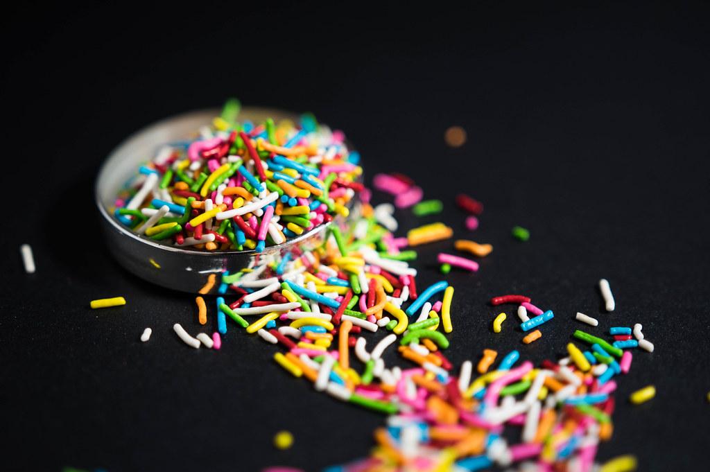 Rainbow sprinkles on a black surface | ✅ Marco Verch is a