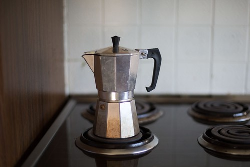 gray moka pot on electric coil stove selective focus photo - Credit to https://myfriendscoffee.com/ | by John Beans