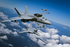 In this file photo, NAS Lemoore-based F/A-18E Super Hornets from Strike Fighter Squadron (VFA) 136 fly in formation over the California coast in March. (U.S. Navy/MCC Shannon Renfroe)