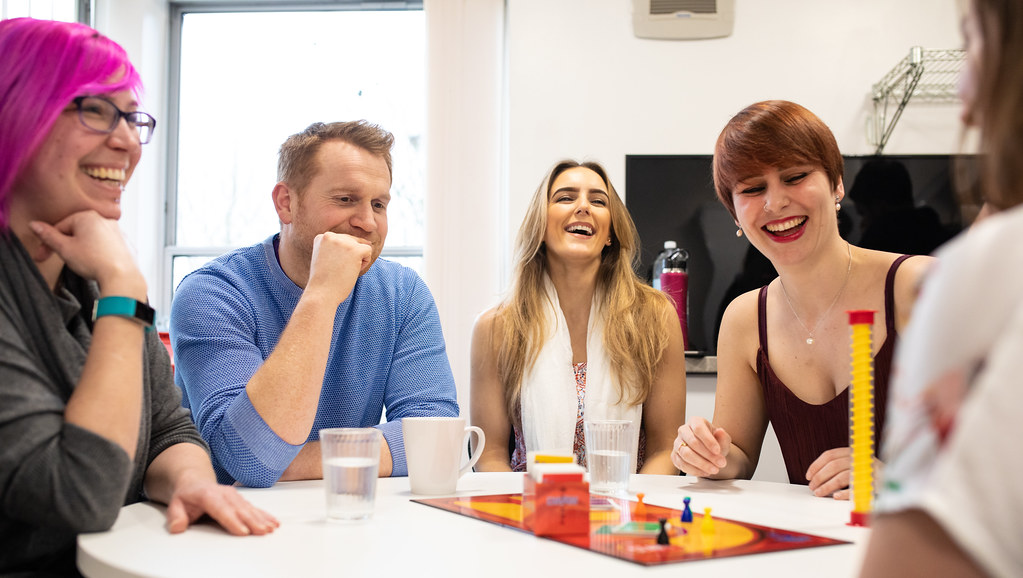 Groups assistants playing a board game