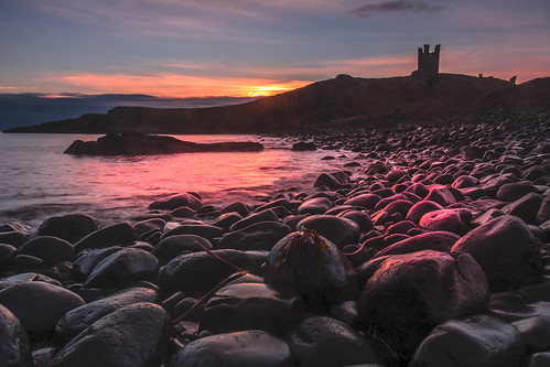 sunrise dunstanburghcastle rocks seaside coastal pink castle blackrocks northeastengland celebrateneengland
