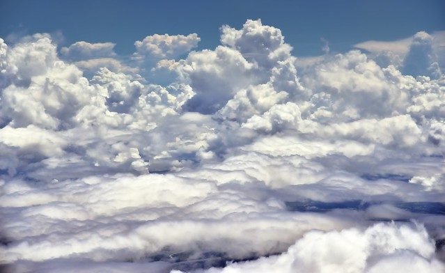 A Plane Window View to Clouds that Come in All Shapes and Sizes