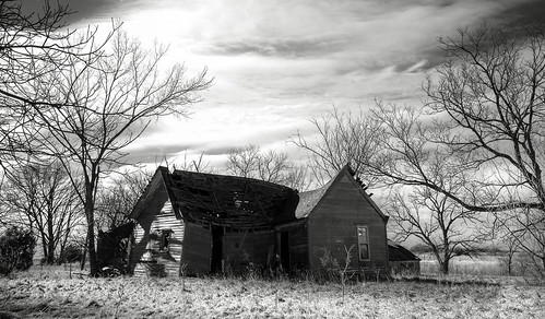 abandonedhouse baretrees sky clouds shadows horizon monochrome opendoorway brokenroof collapsing peelingpaint winter blackandwhite weathered barewood cloudsstormssunsetssunrises htmt