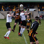 Huntly Captain Michael Clark goes up for a header