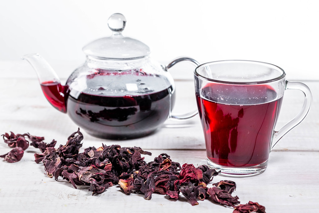 Brewed Hibiscus Tea In A Glass Teapot And A Cup With Dry H Flickr
