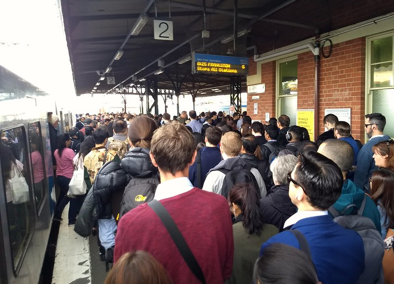 Caulfield station: a crowd exits the train to change to rail replacement buses