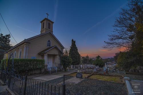 church building sanctuary architecture cross catholic christian parish cemetery sky morning dawn sunrise graves