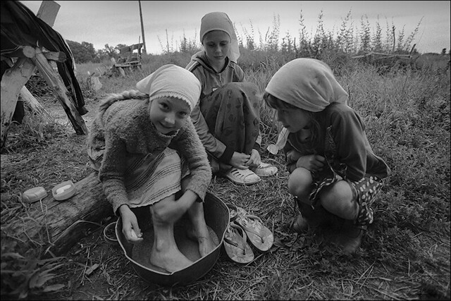 Girls wash their feet after working in the garden