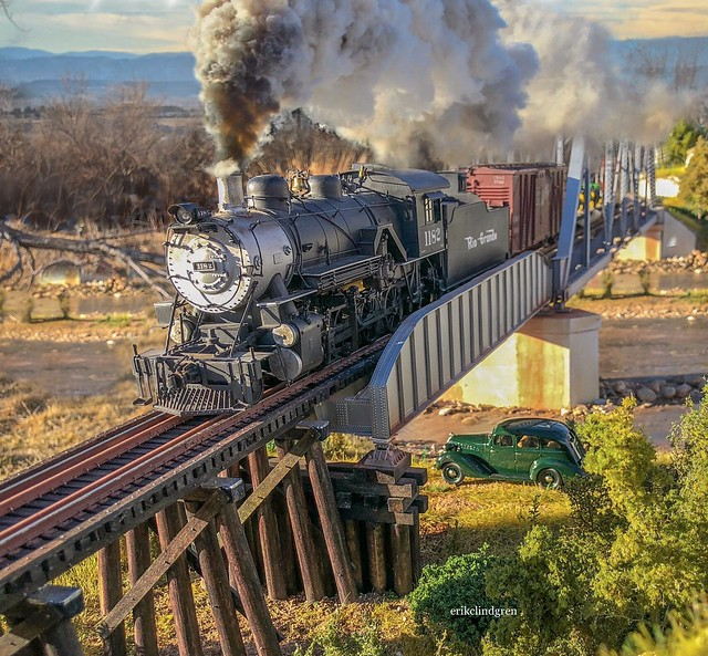 Rio Grande class C48 2-8-0 rolls southbound over St Vrain River with a local merchandise in O Scale