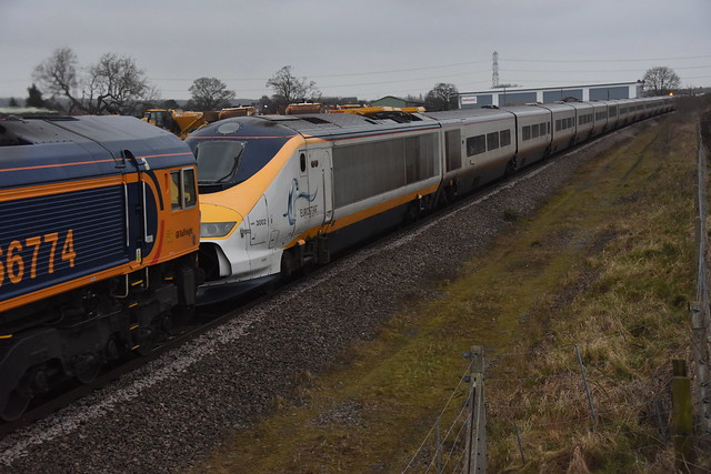 66774 EP with PIONEER EUROSTAR 3733001 3733002 passes through BURTON ON TRENT near CENTRAL RIVERS on route with the 6X73 23:35 LONDON ST PANCRAS INTERNATIONAL - KINGSBURY Sidings for the cutters torch , Saturday 17th March 2018 before the BEAST FROM THE E