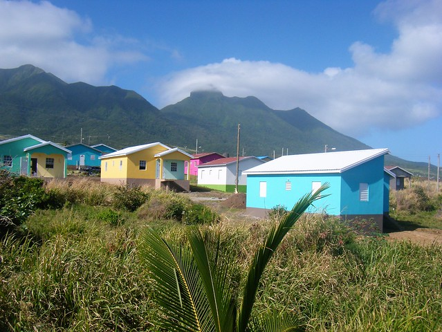 St Kitts = colourful houses near scenic railway line