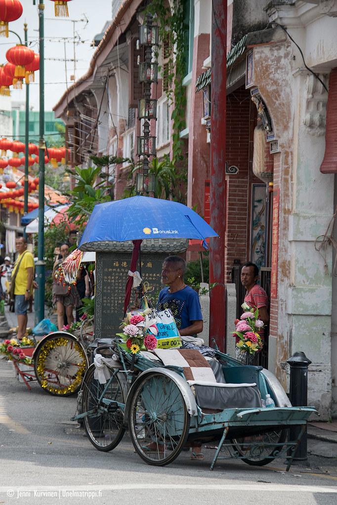 Polkupyöräriksakuski George Townissa Malesiassa