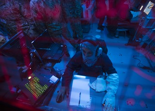 Fire Controlman (Aegis) 2nd Class Savian Wadsworth stands watch in the combat information center aboard USS Porter (DDG 78).   by Official U.S. Navy Imagery