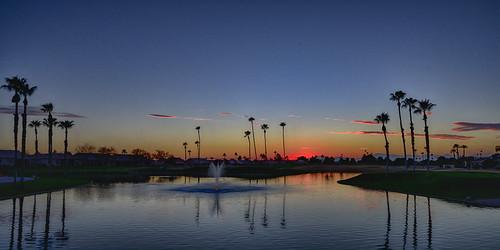 arizona oakwood sunlakes lake sunset sun trees palms landscape winter respite chandler fountain nikonz7 water clouds wideangle sky evening dusk