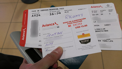 Boarding pass and food voucher | by A. Wee