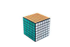 Solved Rubik's cube 7x7x7 on white background with green, white and orange sides