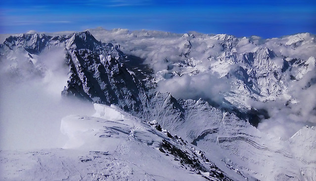 Clouds and fog in the snow-capped mountains