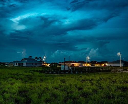 ef24105mmf4l sonyilce7rm2 landscape neighborhood evening storm clouds