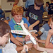 Schoolchildren admire the model plane they and their teacher built using a CAP aerospace education STEM (science, technology, engineering and math) Kit. Photo // Civil Air Patrol