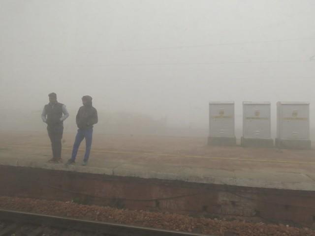 foggy railwaystation through a dirty window