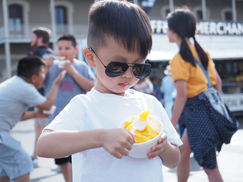 Cute kid eating Mango Freeze on Day 2 of French Quarter Fest - 4.12.19. Photo by Michele Goldfarb.