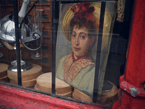 Painting of a woman in an antique shop | by sixthland
