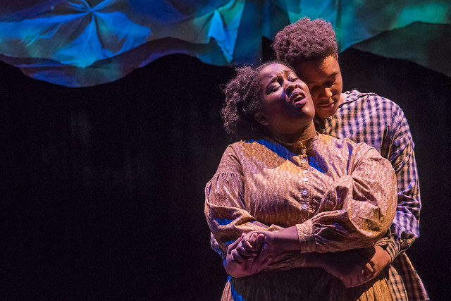 A couple embraces on stage during a production of Alabama Love Stories.
