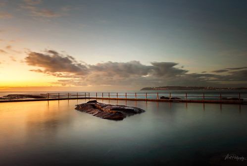 australia nsw sydney rock pool coastal sunrise dawn ocean fence posts reflection clouds tranquility