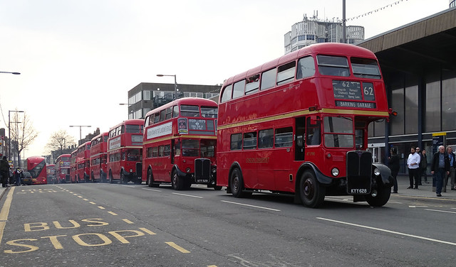 LONDON TRANSPORT RED RT BUSES . WHO SAID BUSES ALWAYS COME ALONG IN THREE'S . SEVEN OR EIGHT IN THIS LINE ON AN EAST LONDON BOROUGH SUBURB STREET ENGLAND DSC01770