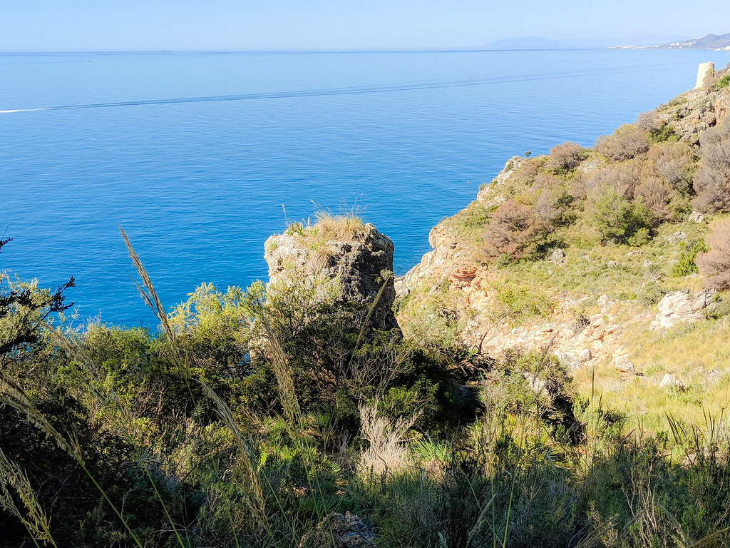 A view towards the blue sea from the top of the cliffs