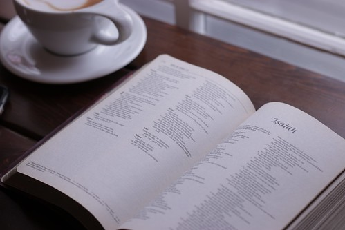 open Bible in showing Isaiah chapter on table near cup of coffee - Credit to https://myfriendscoffee.com/ | by John Beans