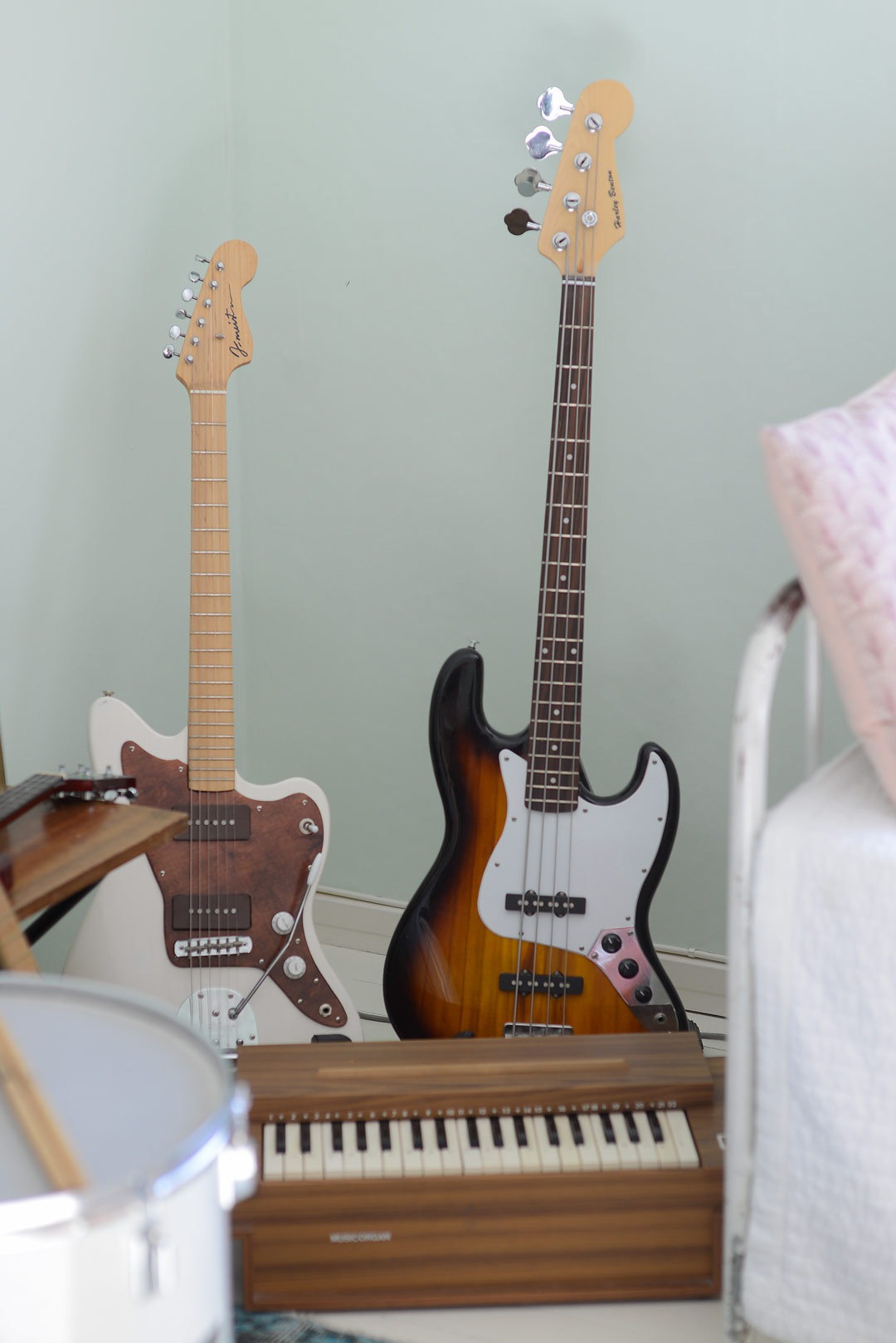 A DIY guitar and a second hand bass guitar