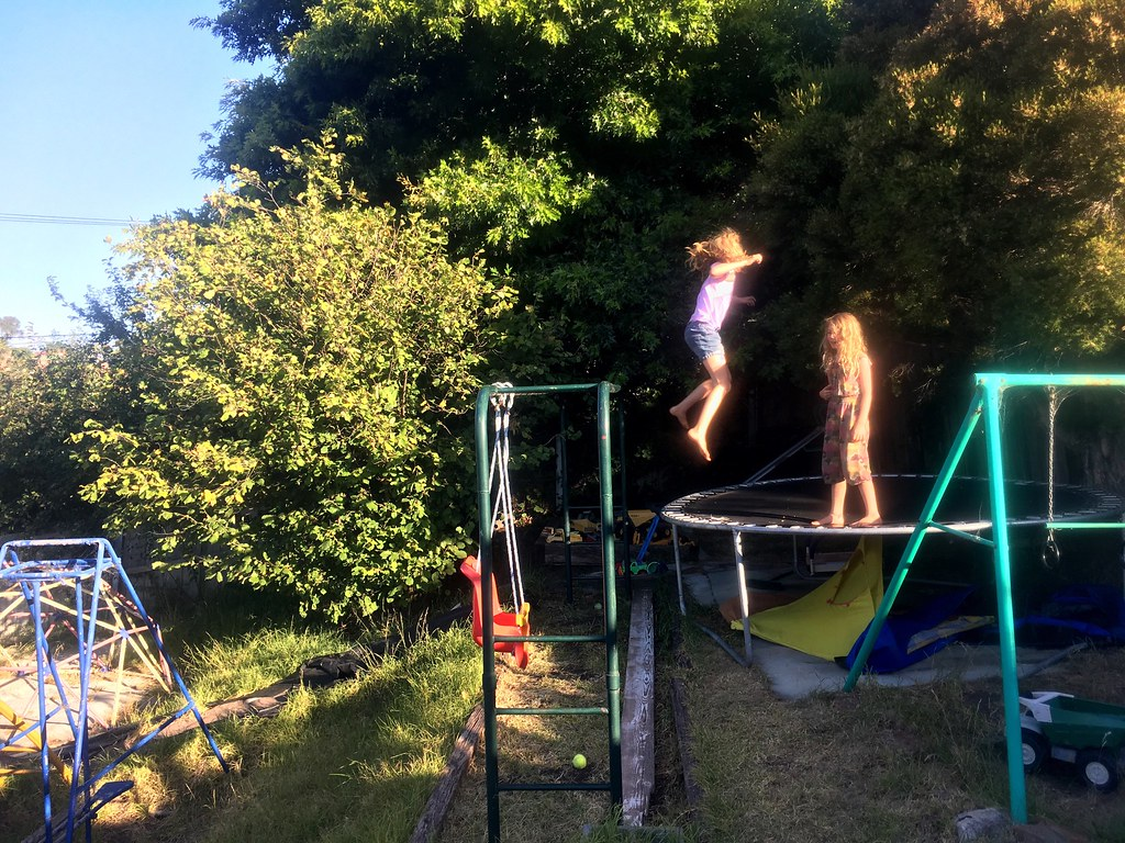 Jumping from the monkey bars on to the trampoline.