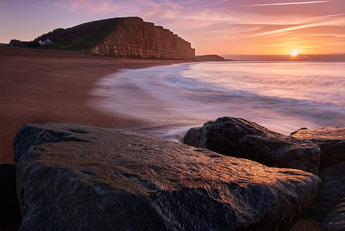 breathtakinglandscapes england dorset beach waves sand shore surf cliff sunrise rock lowtide calm