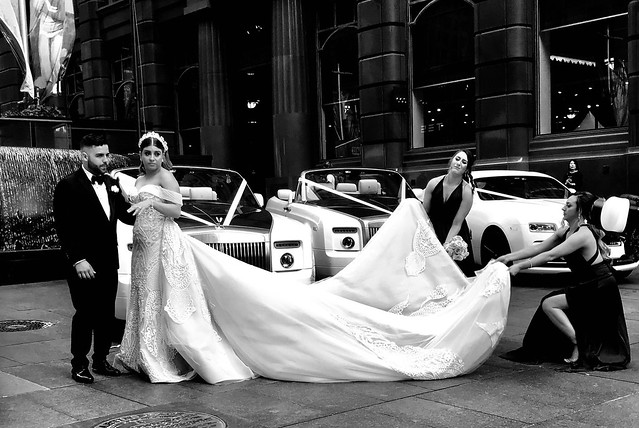 Wow, that's what I call a wedding dress drag, not to mention the cars!