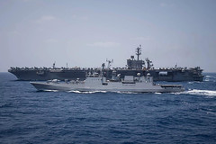 In this file photo, the Indian Navy frigate INS Tarkash (F50) transits alongside the aircraft carrier USS Theodore Roosevelt (CVN 71) earlier this year in the Indian Ocean. (U.S. Navy/MC3 Morgan K. Nall)