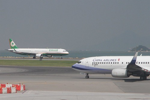 China Airlines Boeing 737-809 B-18605 passes EVA Airways Airbus A321-211(WL) B-16218 at Hong Kong International Airport